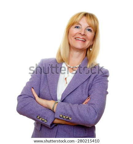 Happy and smile old senior woman 60-65 years with white teeth, in suit and with big blue eyes, crossed arms, isolated on white background, Positive human emotion, facial expression