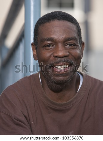 Happy and smiling African American man outdoors - stock photo