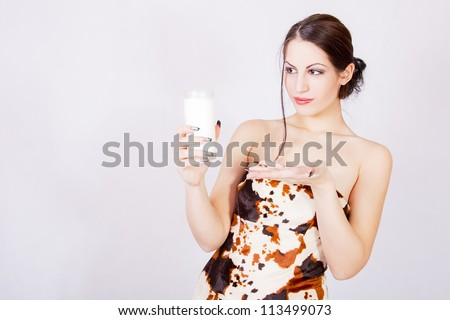 happy and smiling beautiful young woman enjoying a glass milk