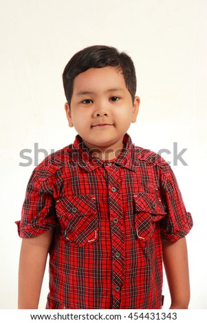 Happy and smiling cute Asian boy half body portrait on white background