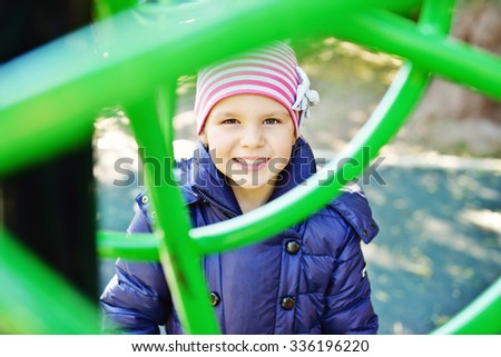 happy and smiling girl on the playground