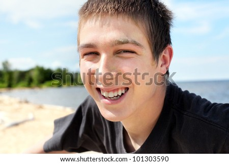 happy and smiling teenager portrait outdoor