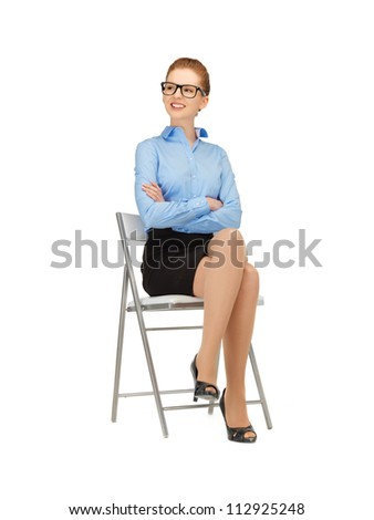 happy and smiling woman on a chair  in specs - stock photo