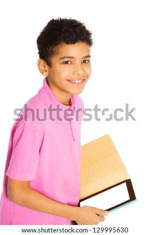 Happy and smiling 10 years old black boy standing with tablet computer, isolated on whtie - stock photo