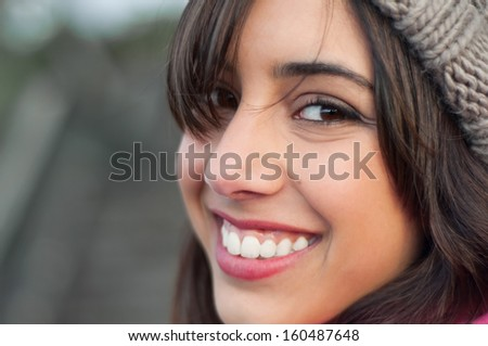 Happy and smiling young woman's portrait