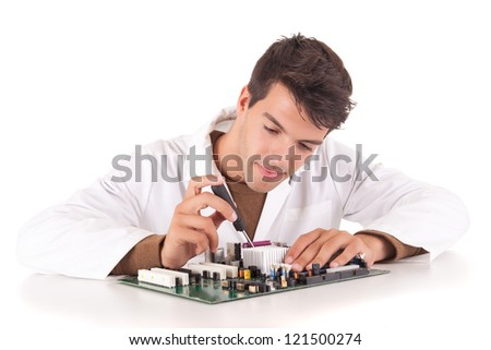 Happy and successful young computer engineer - stock photo