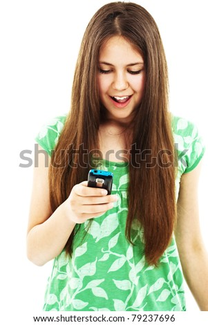Happy and surprised teenager girl looking on mobile phone - stock photo