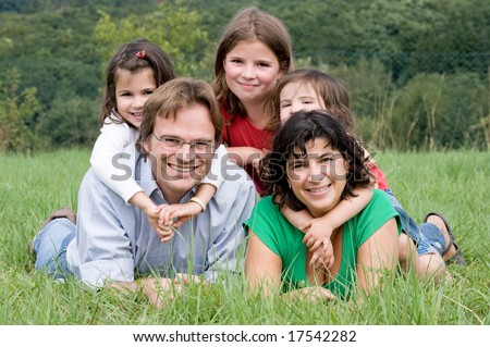 Happy and young family in a farmer´s field