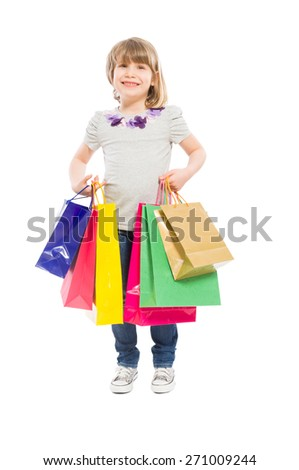 Happy and young shopping girl holding gifts on white background - stock photo