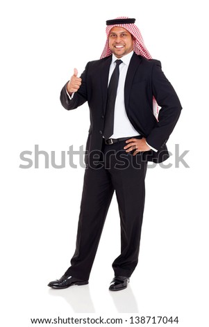 happy arab man in black suit giving thumb up on white background - stock photo
