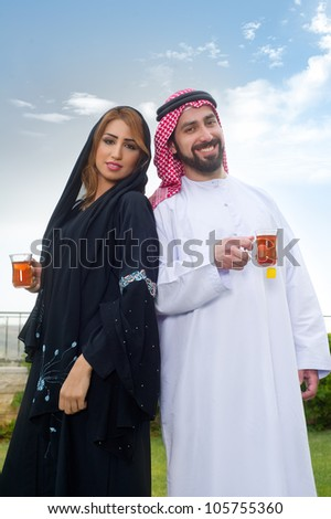 Happy Arabian couple enjoying time  & drinking tea - stock photo