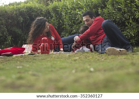 Happy Arabian Family in Winter Red Clothes outdoors at Christmas and New Year Theme Concept