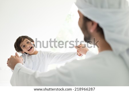 Happy Arabic family, father and son