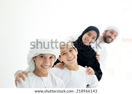 Happy Arabic family in row smiling