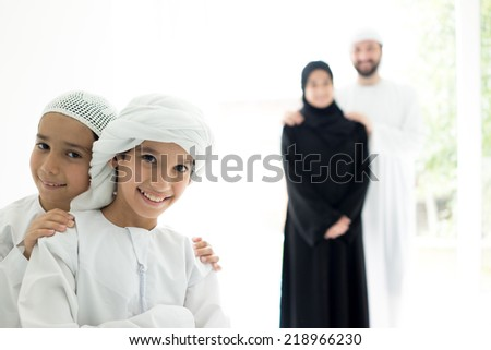 Happy Arabic family in row smiling - stock photo