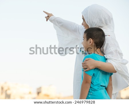 Happy Arabic Muslim Middle Eastern family - stock photo