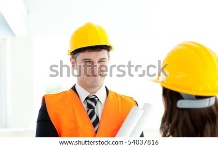 Happy architect discussing with his colleague against a white background