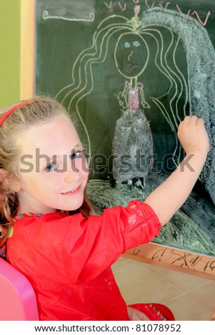 happy artistic,kid,drawing on blackboard in school or home - stock photo