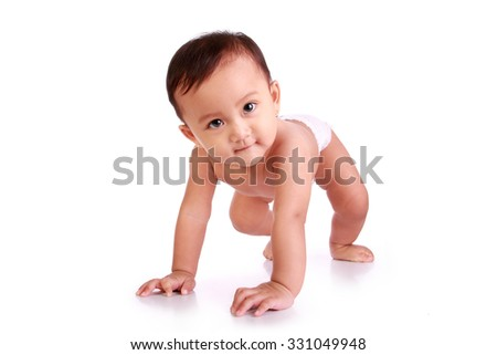 Happy Asian baby crawls and smiles at camera, isolated on white background - stock photo