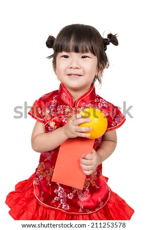 Happy Asian baby girl in red Chinese suit with oranges