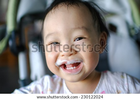 Happy Asian baby with diry mouth. - stock photo