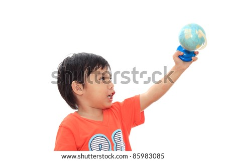 Happy asian boy with globe isolated on white background - stock photo