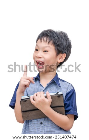 Happy Asian boy with tablet computer over white background