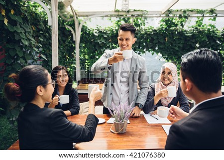 happy asian business Friends Cheering With Coffee at cafe - stock photo