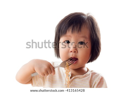 Happy Asian child eating delicious noodle in white background