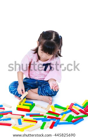 Happy asian child. Pretty girl playing toy wood blocks, isolated on white background. Educational toys for kindergarten child. Strengthen the imagination of child. Studio shot.