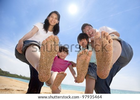 happy asian family enjoy summer time on the beach - stock photo