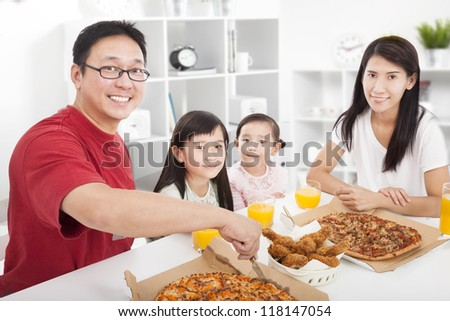 happy asian Family enjoy their dinner in the home - stock photo