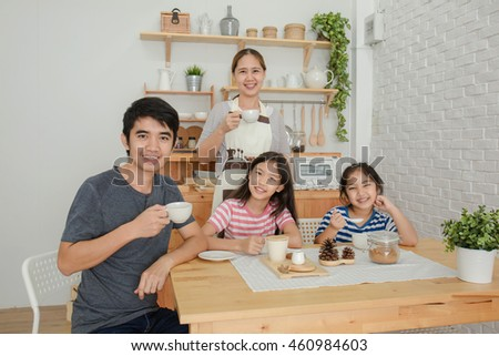 Happy Asian family have a breakfast together in the morning