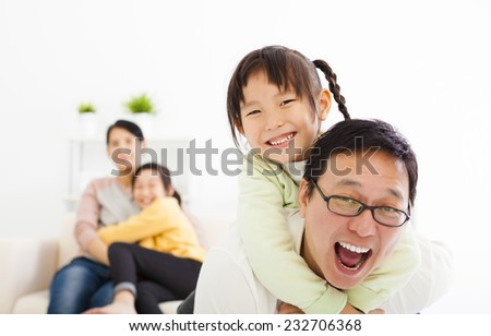 happy asian family in the living room - stock photo