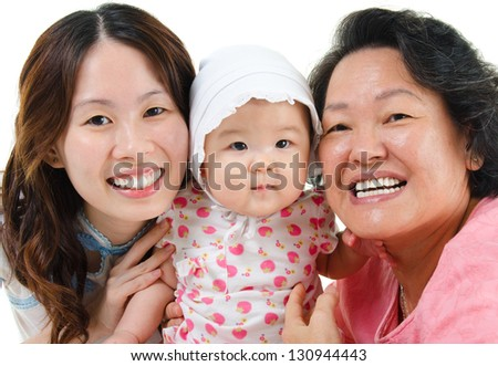 Happy Asian family isolated on white. Three generations Asian family, grandmother, mother and granddaughter.