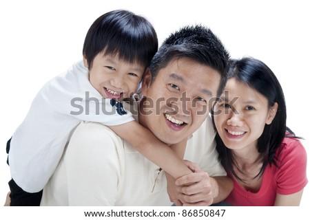 Happy Asian family on white background - stock photo