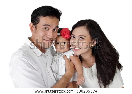 Happy Asian family portrait. Daddy and mommy with their little baby girl, isolated on white background - stock photo