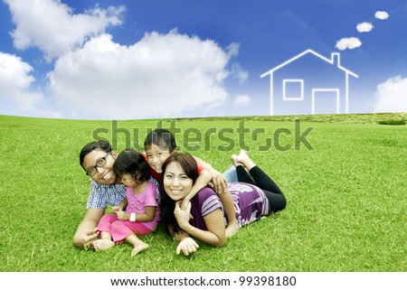Happy asian family posing with their dream house outdoor - stock photo