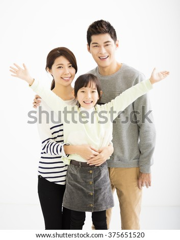 happy asian family standing together