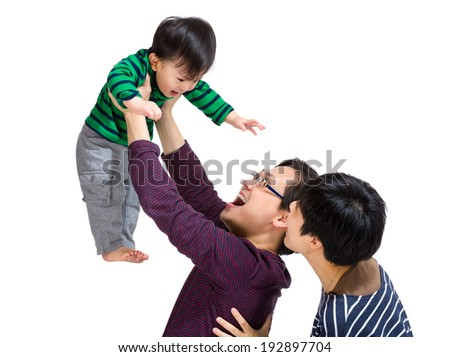 Happy asian family with dad throwing up - stock photo