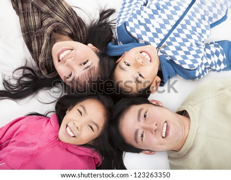 Happy asian  family with heads together - stock photo