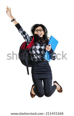 Happy asian female student jumping on white background - stock photo