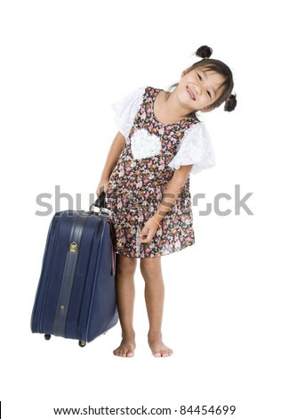 happy Asian girl carrying her heavy luggage over white background