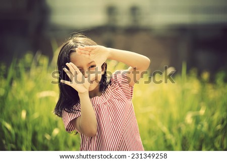 Happy asian girl playing outdoor in sunny day with retro style - stock photo