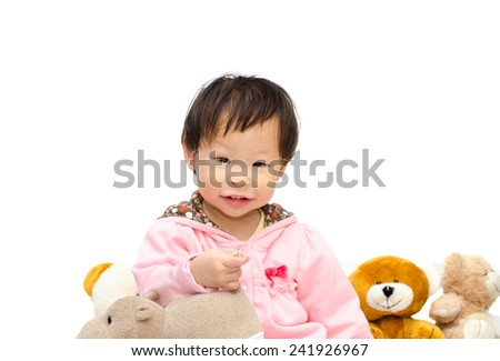 Happy Asian girl  playing with bear and hippo toy
