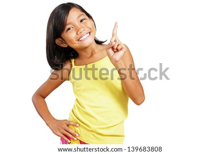 Happy asian girl showing her index finger. A success concept.focus is on the hand. - stock photo