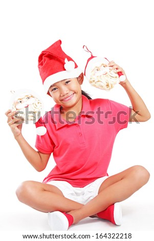 Happy asian girl showing image of Santa Claus head. Isolated in white background. - stock photo