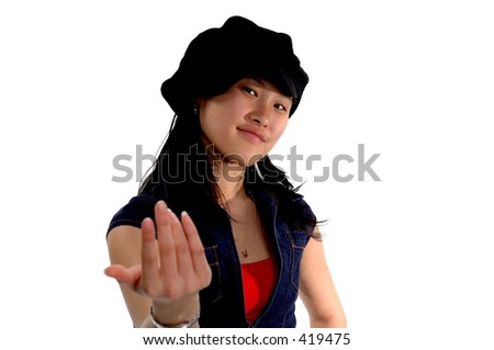 Happy  Asian girl smiling in a cute hat beckoning the camera forward