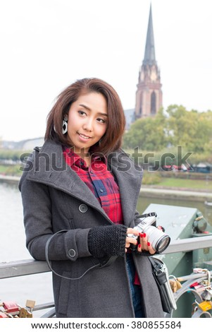 Happy Asian Girl with Camera, Travel in Europe  - stock photo