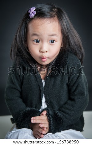 happy asian girl with cute face isolated on black background